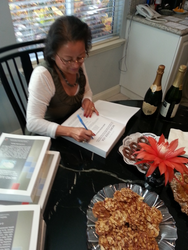Maliha Signs Books at Book Signing